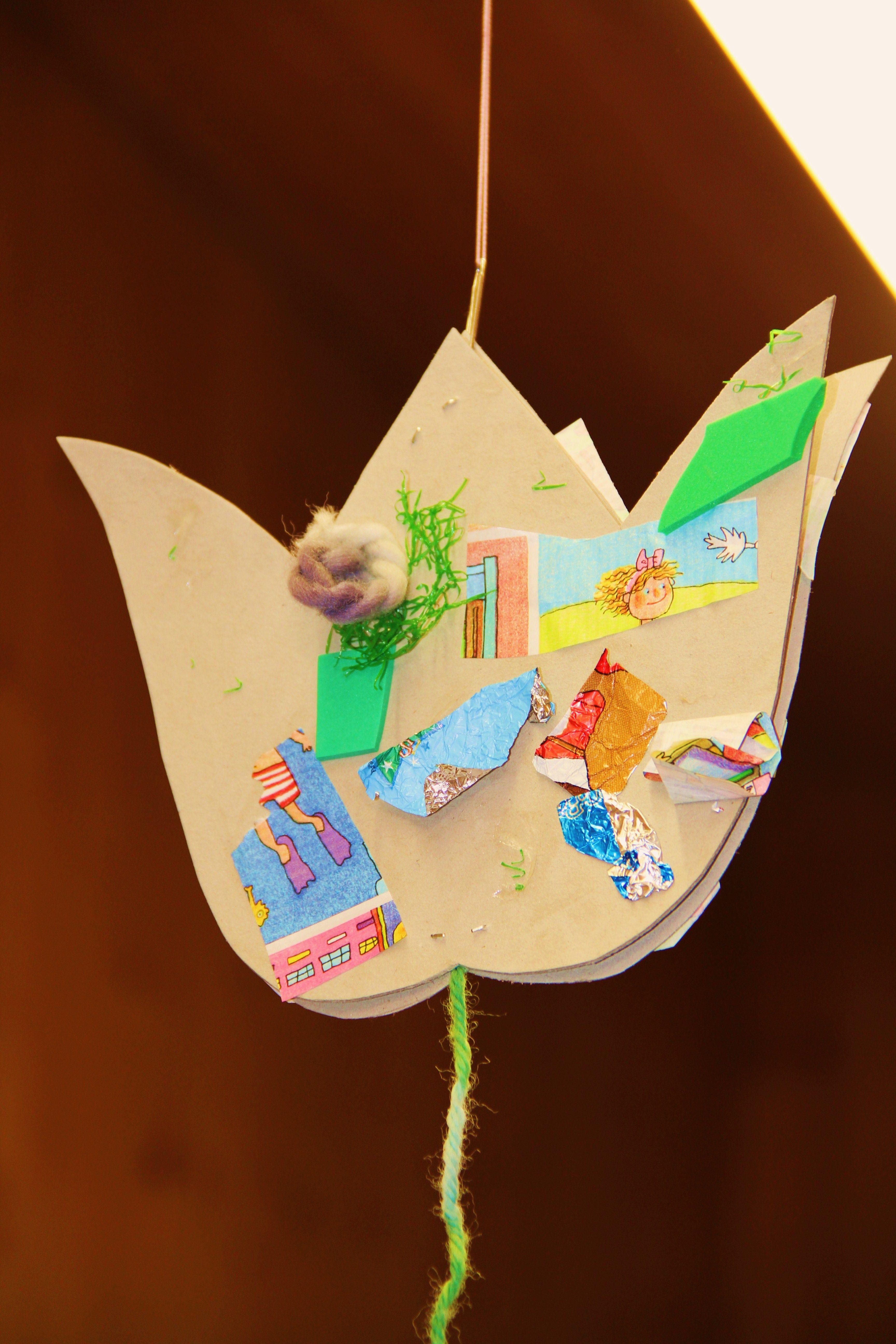 Blume mit Krims-Krams beklebt
