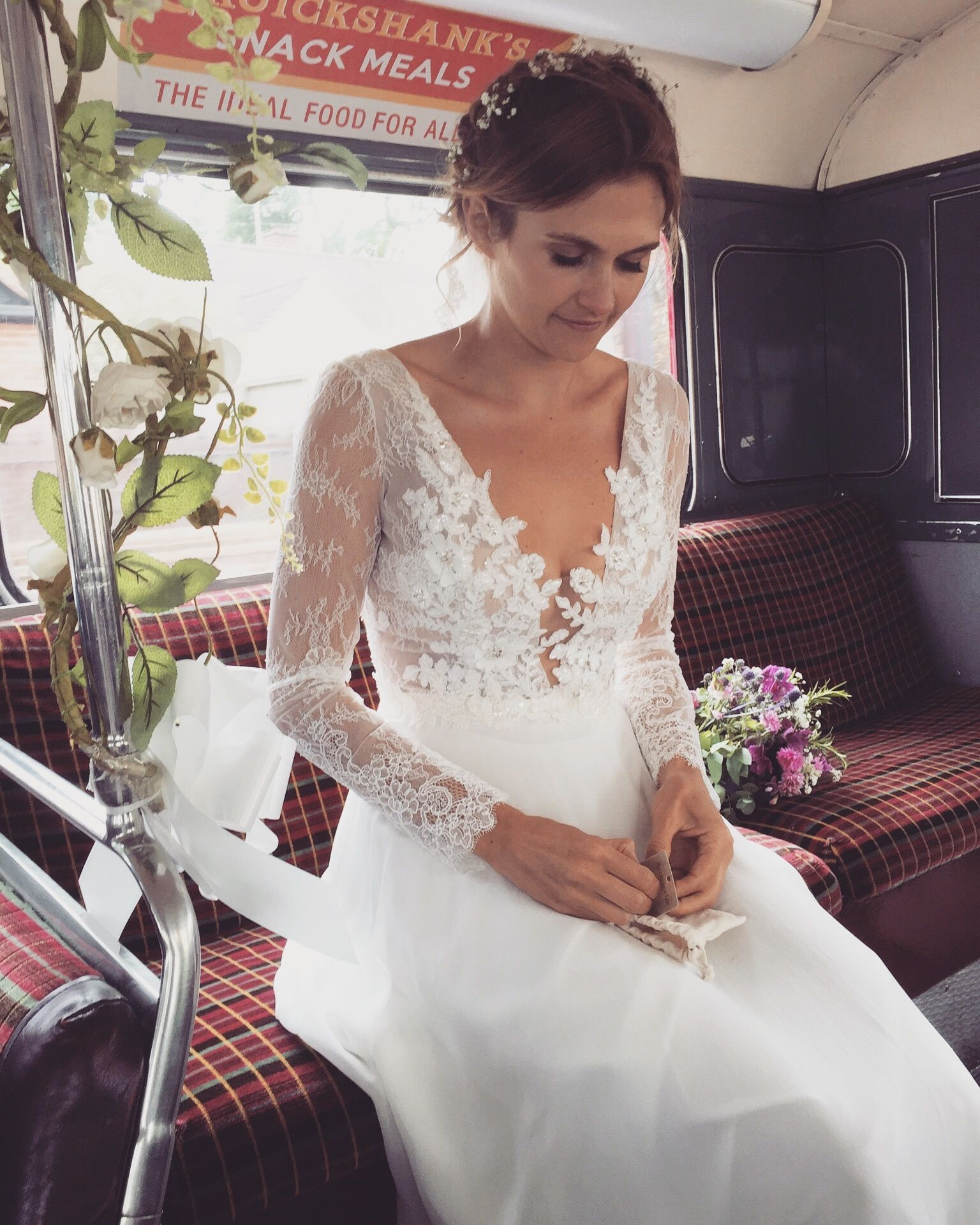 4757b1fa899a Me in my long sleeve lace wedding dress putting on my earrings on our route-