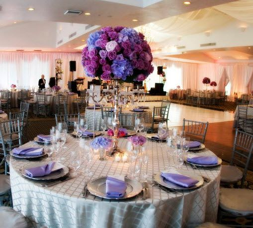 Lovely table with great colors and an arrangement tall enough for the guests to be able to talk across the table!
