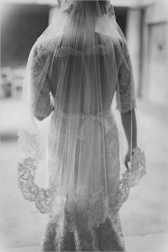 lace wedding veil over sheer back gown by Kara Gowns