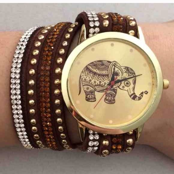 Brown Elephant Watch NWOT brown wrap around elephant watch with snap buckle closure Accessories Watches