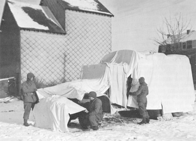 BED SHEETS DONATED BY VILLAGERS camouflage 6th Armored Division vehicles.
