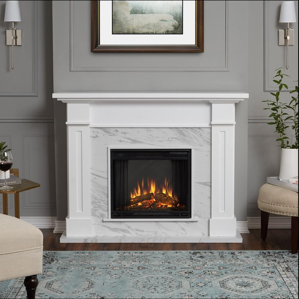 Real Flame Kipling 54 In Freestanding Electric Fireplace In White With Faux Marble 6030e Wm The Home Depot Indoor Electric Fireplace Fireplace Design Fireplace Remodel
