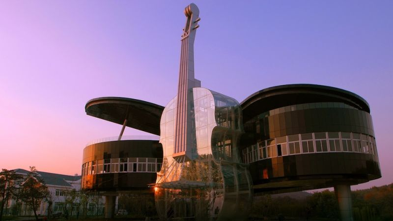 Piano and Violin Building, Huainan City, China, built in 2007 to promote a newly-developed area, designed by some students of Hefey University of Technology with the designers of the company Huainan Fangkai Decoration Project Co. These Are The Most Extreme Buildings Ever