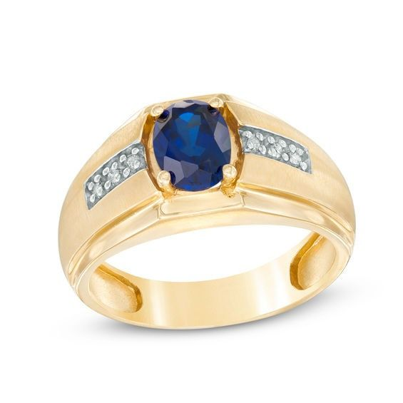 Men S Oval Lab Created Blue Sapphire And Diamond Accent Ring In 10k Gold Blue Sapphire Ring Designs Sapphire