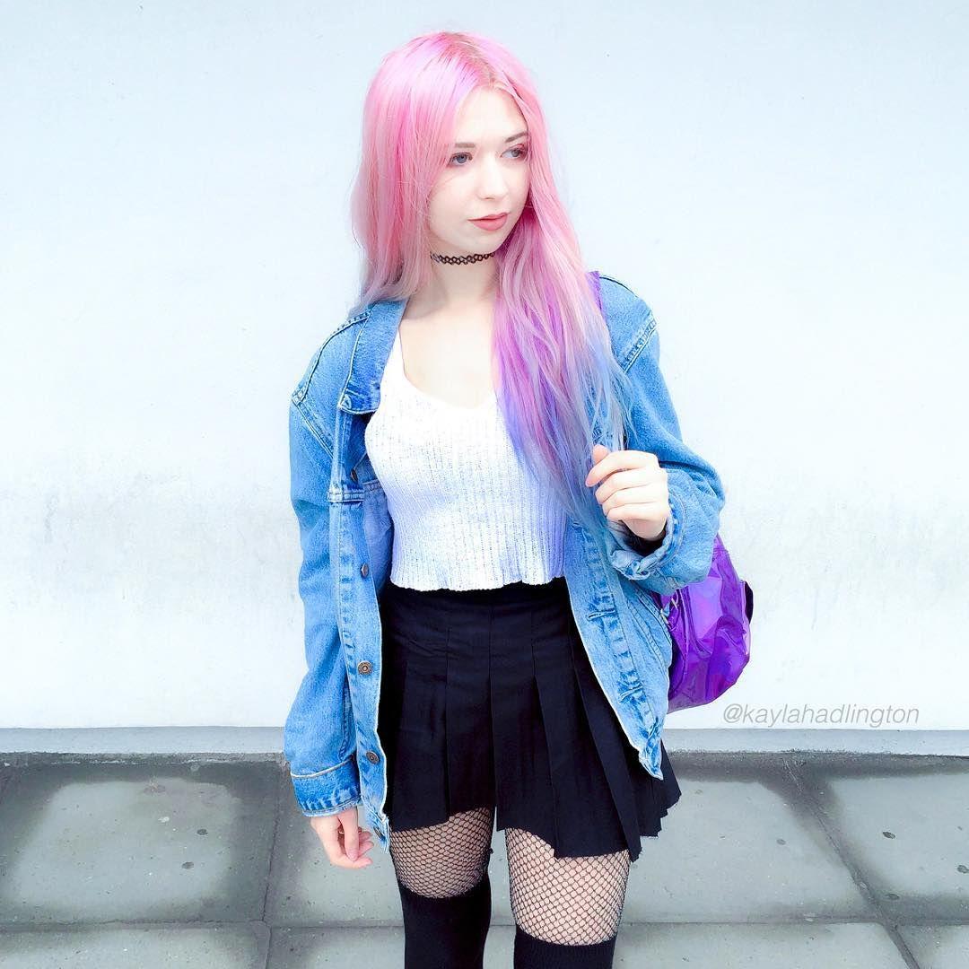 Choker + white vest top + denim jacket + black skater skirt + tights + knee high socks + holographic rucksack