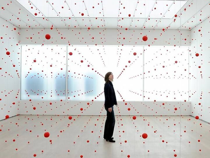 German artist Katharina Hinsberg's installation titled Mitten, roughly translated as Middle, features a network of red beads hanging in a grid-like formation.