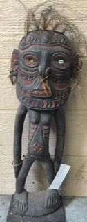 MINDIMBIT VILLAGE, IATMUL TRIBE MIDDLE SEPIK RIVER, PAPUA NEW GUINEA CARVED WOODEN ANCESTOR FIGURE ON METAL BASE. ANCESTORS ASSIST THEIR DESCENDANTS WITH FOOD, HEALTH, ADVICE AND COUNTER SORCERY ATTEMPTED VIA THE ANCESTOR SPIRIT PLANE. THE ANCESTOR FIGURES ARE KEPT IN THE HAUS TAMBARAN AND IN THE HOME. MEASURES 28 INCHES IN HEIGHT.