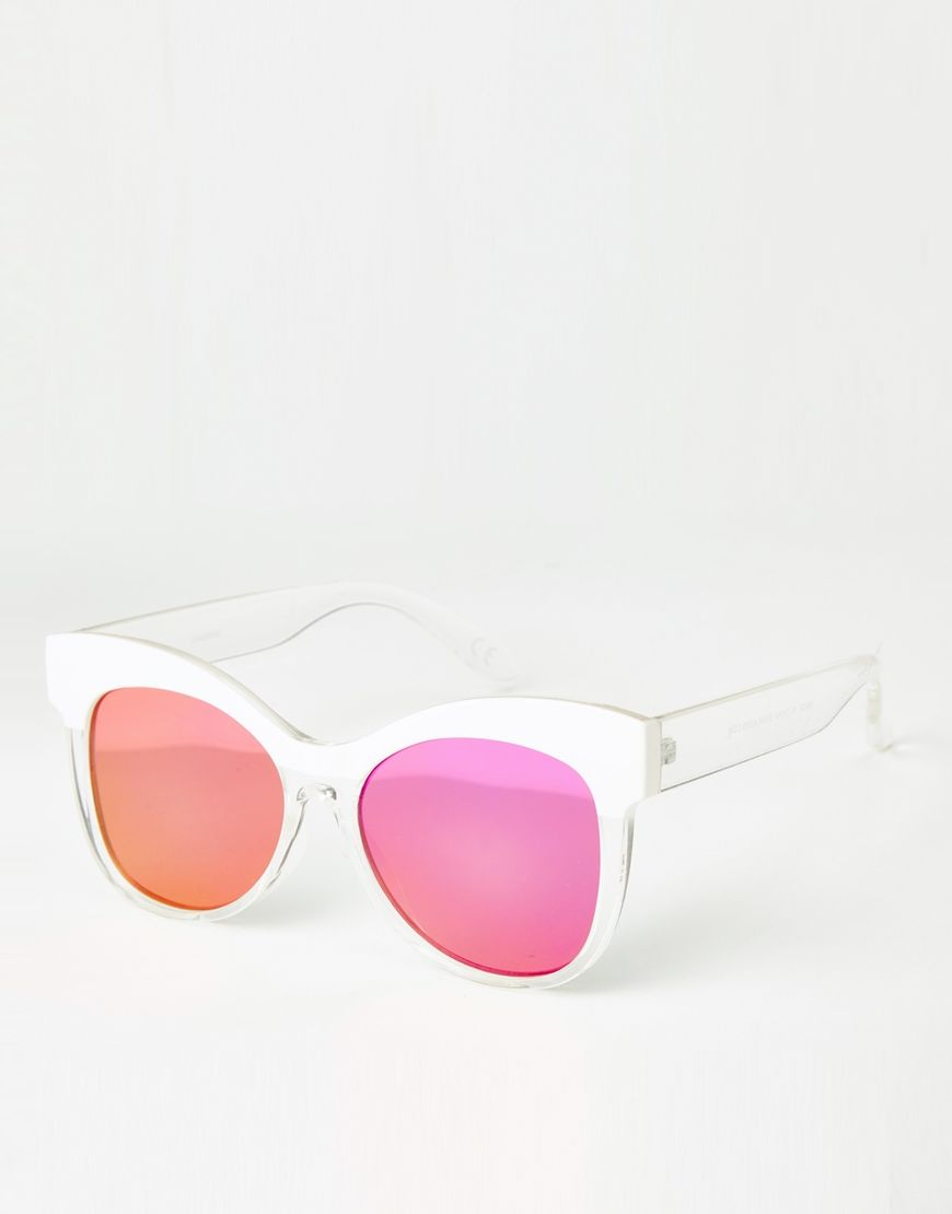 These white-framed sunglasses with vibrant lenses are a spring + summer must-wear.
