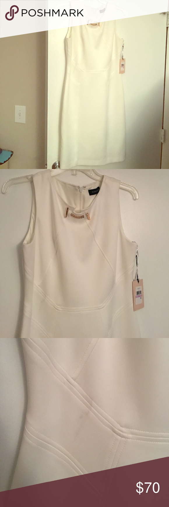 White ivanka trump dres Size 6, has smudge as shown in pic that looks like it would be easy to get out. I'm typically a size 4/6 and its big on me. Would recommend for an 8. New with tags! Reasonable offers only! Ivanka Trump Dresses