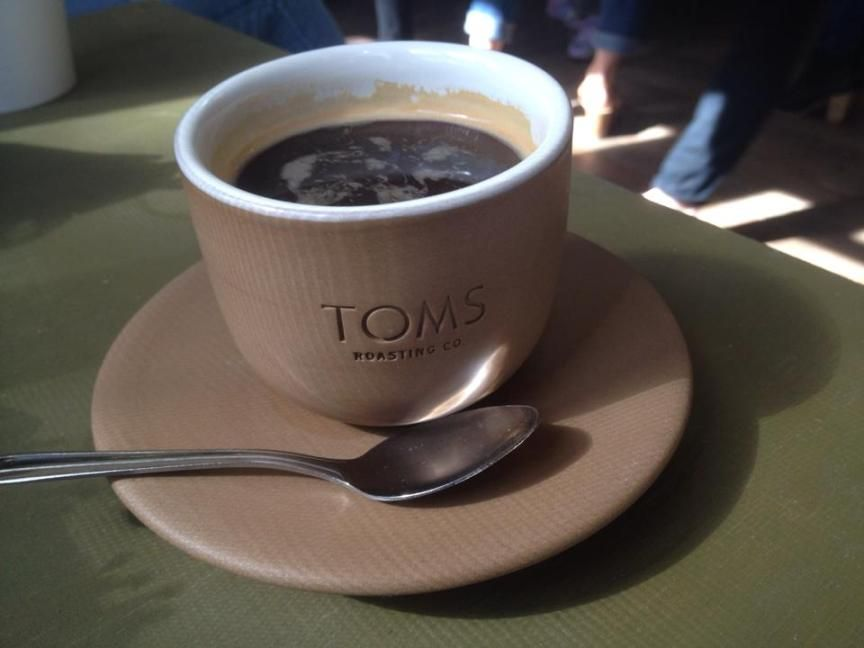 A cup of toms roasting coffee in austin coffee roasting