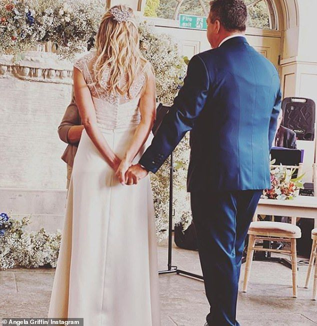 Touching moment: Other snaps from the star-studded bash show the couple sweetly holding hands as they exchanged their vows