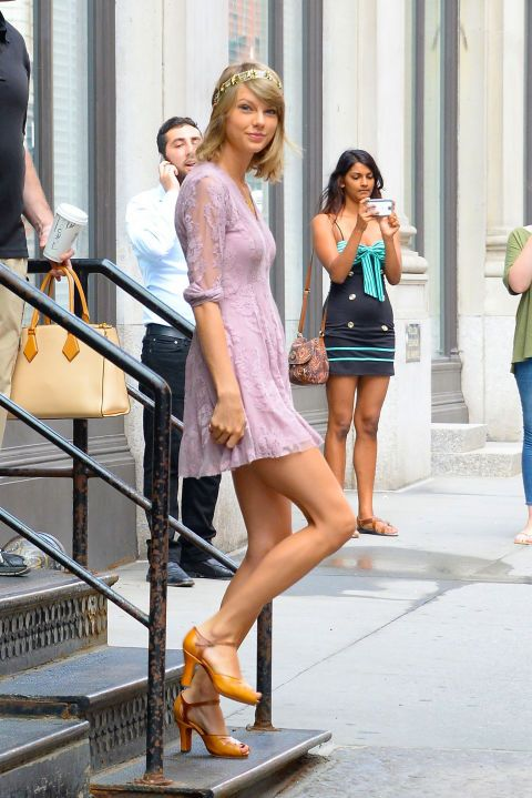 Out in the Soho neighborhood in New York City on July 13, 2015...always has great style!  #TaylorSwift...in a #freepeople lavender dress and headband.