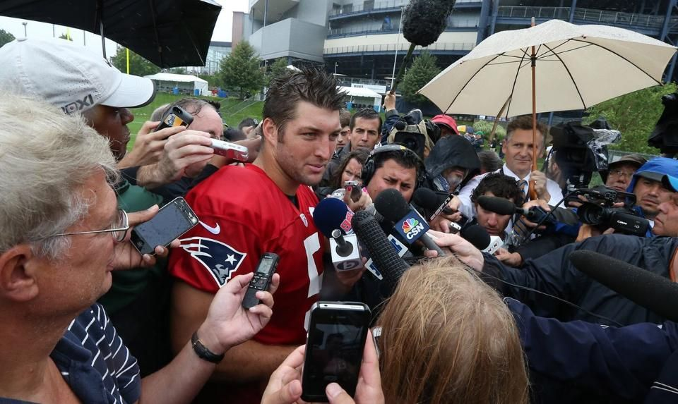 Tim Tebow talks with the media 7-26-13