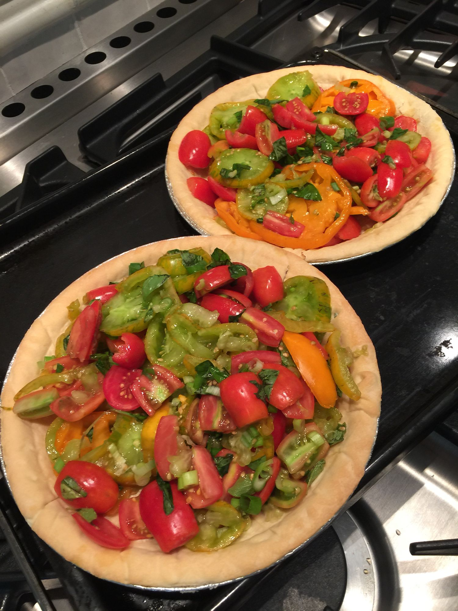 Cheese tomato pie -- 3 types of tomatoes from our garden as well as fresh herbs --Oregano & Basil.