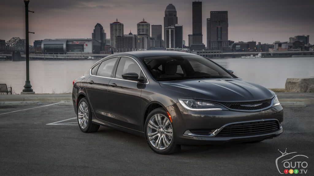 2015 Chrysler 200 With Downtown Montreal In The Background Read