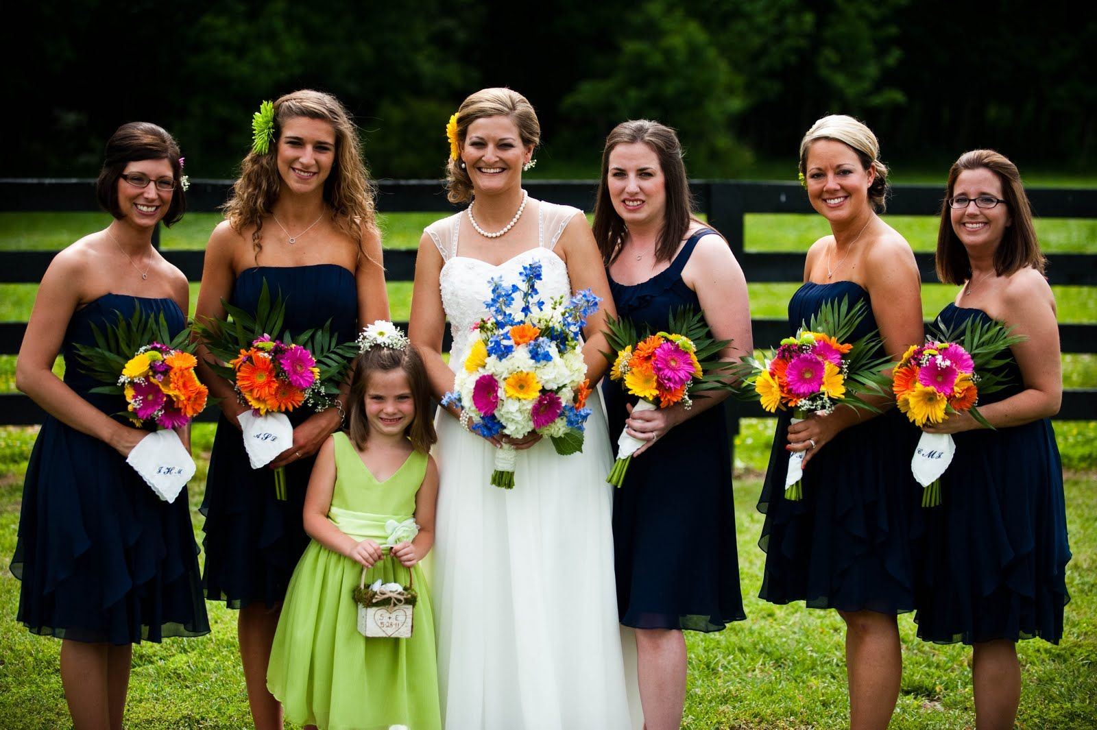 Navy blue bridesmaid dresses with bright pink bouquets navy blue bridesmaid dresses with bright pink bouquets bettydonnephotography ombrellifo Gallery