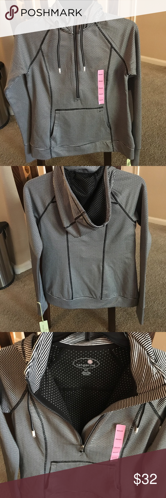NEW Ladies small Tangerine Collared FullZip Hoodie New With Tags ladies small tangerine collared hoodie, black/white, stretchy moisture wicking material. $80 retail price. Good for any weather and any situation!!! Tangerine Tops Sweatshirts & Hoodies
