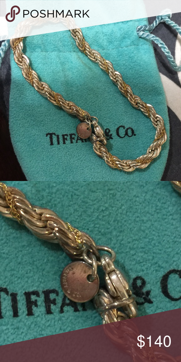 Rare Tiffany silver / gold rope bracelet Rare authentic Tiffany silver / gold rope bracelet ! Sells used for over $300! Needs polishing, but in good condition! Tiffany & Co. Jewelry Bracelets