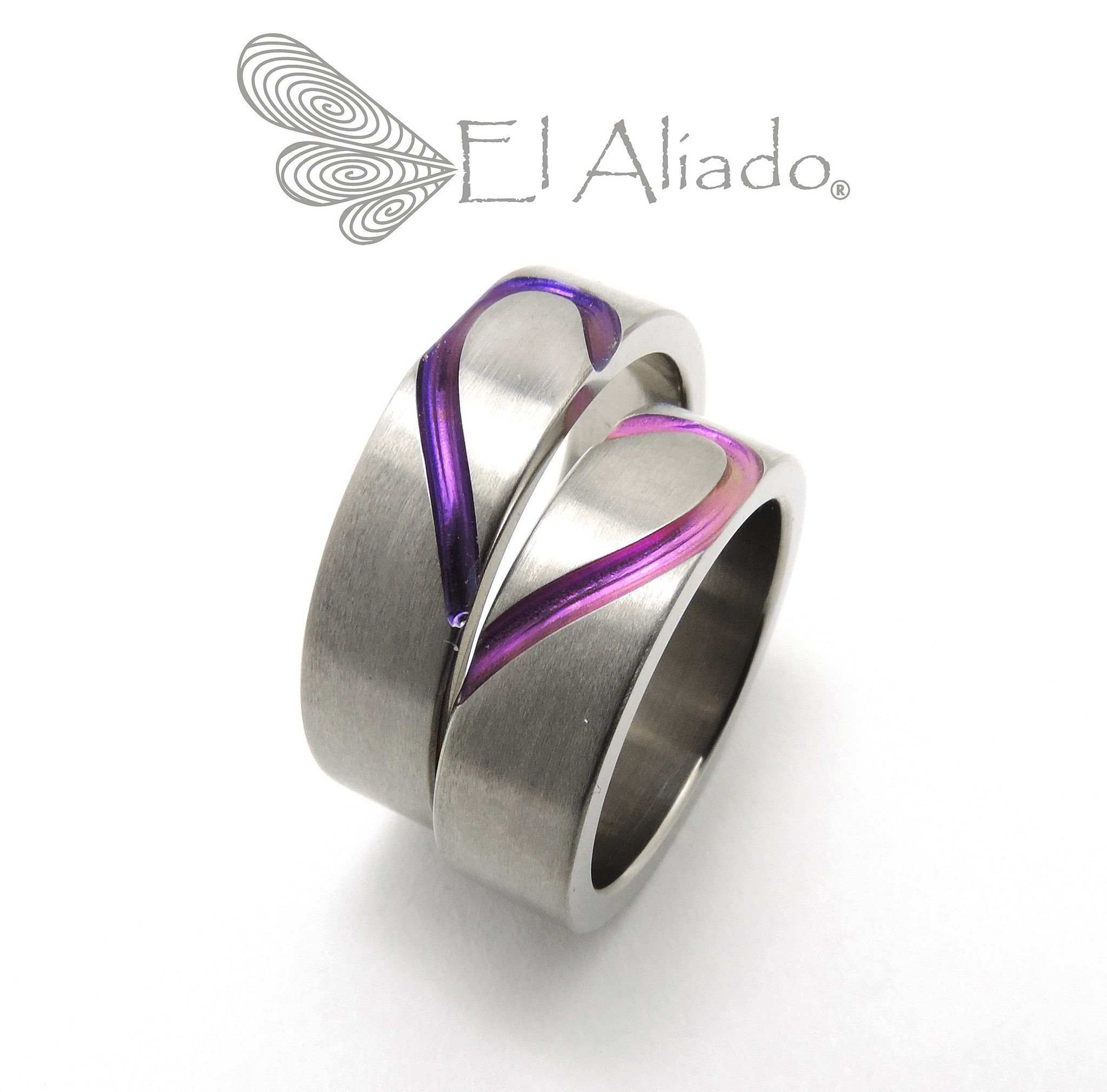https://flic.kr/p/zaxmKw | 911. Argollas corazón en titanio con canal violeta y fucsia | www.elaliadojoyas.com info@elaliadojoyas.com Cel. 3203066543 - 3105753129 - 3002859190 Bogotá - Colombia
