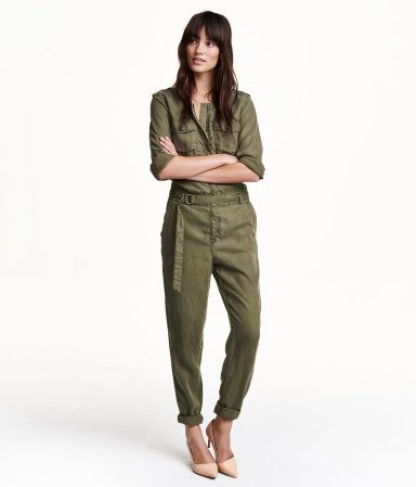 945045ee3659 Jumpsuit in woven Tencel® lyocell with concealed zip at front. Long sleeves  with buttons at cuffs