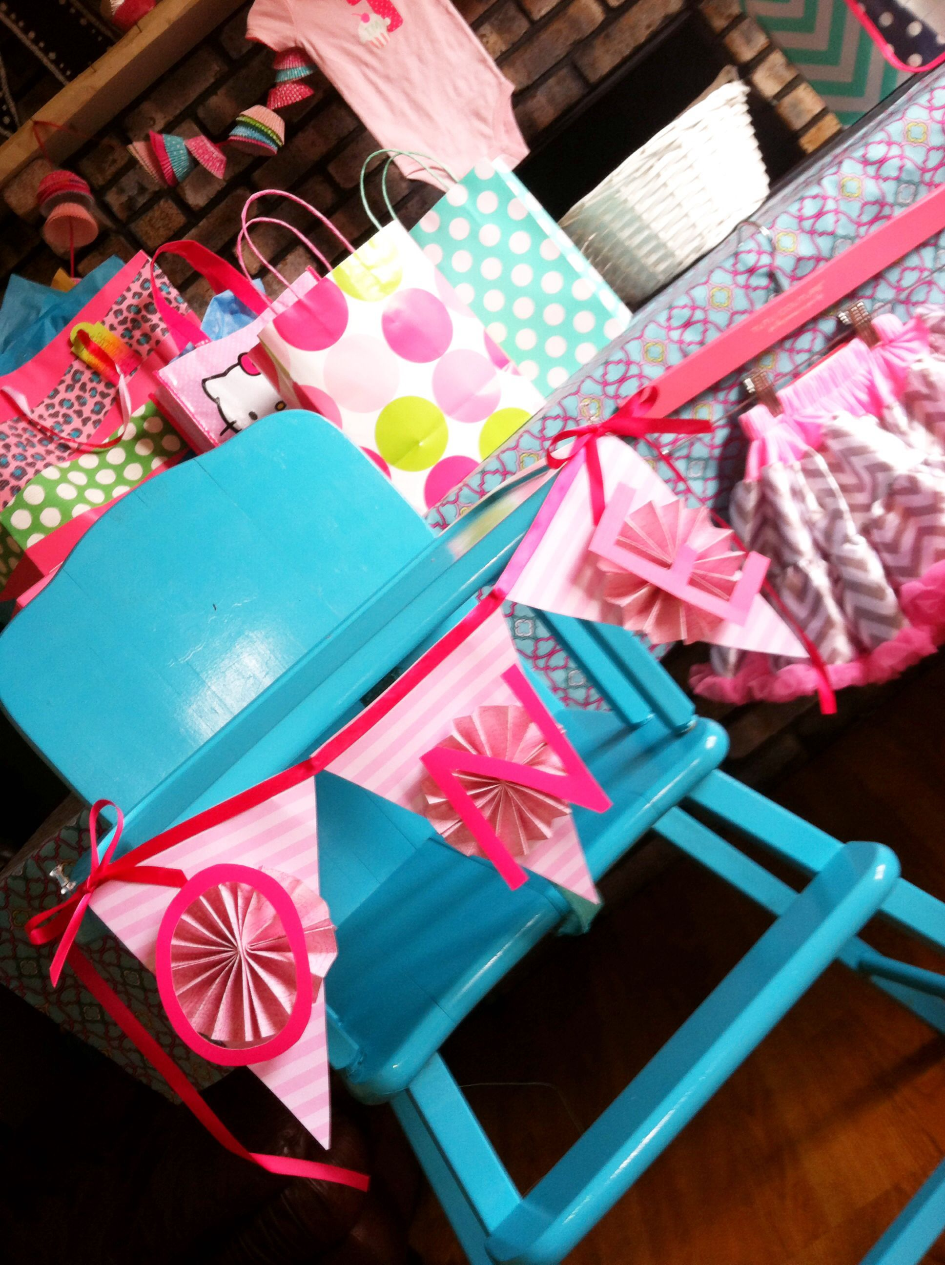 Teal high chair for Mia's birthday party