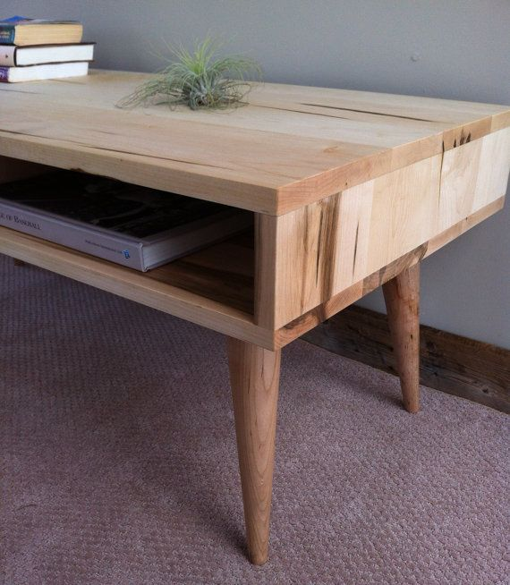 f1851dfd90d7 Mid century modern style coffee table featuring wormy maple and tapered wood  legs