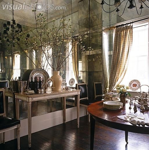 Neo Classical Console Table Against A Smokey Mirrored Wall