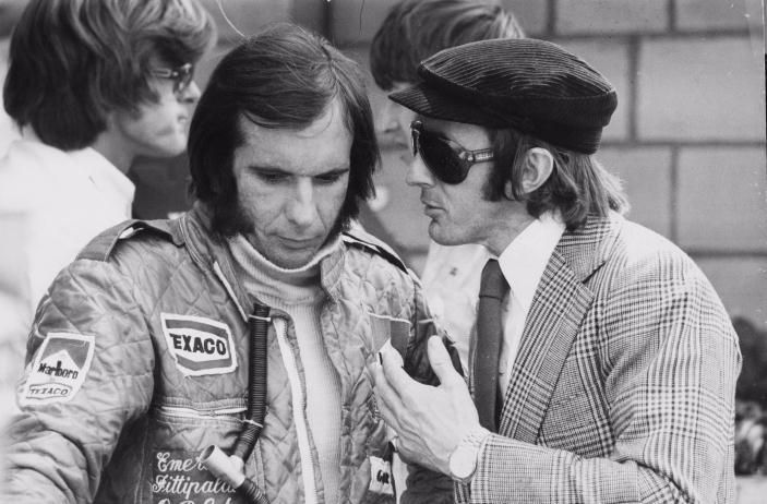 Emerson Fittipaldi, taking advice from Jackie Stewart