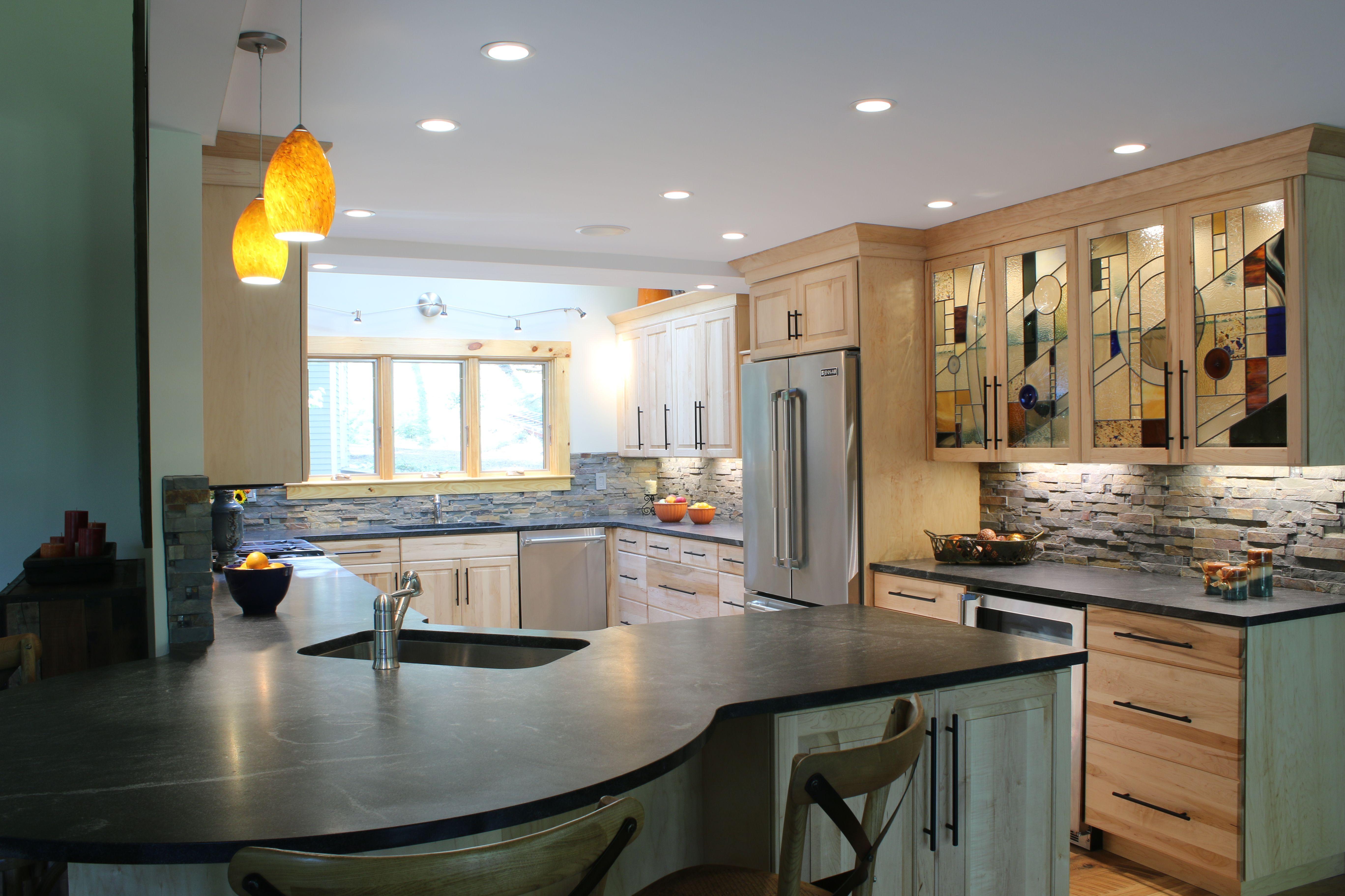 Corner window kitchen sink  transitional kitchen stainless steel appliances corner sink and