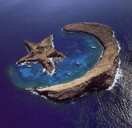 Strange island of Molokini - natural star and crescent - between Maui and Kahoolaw, Hawaii