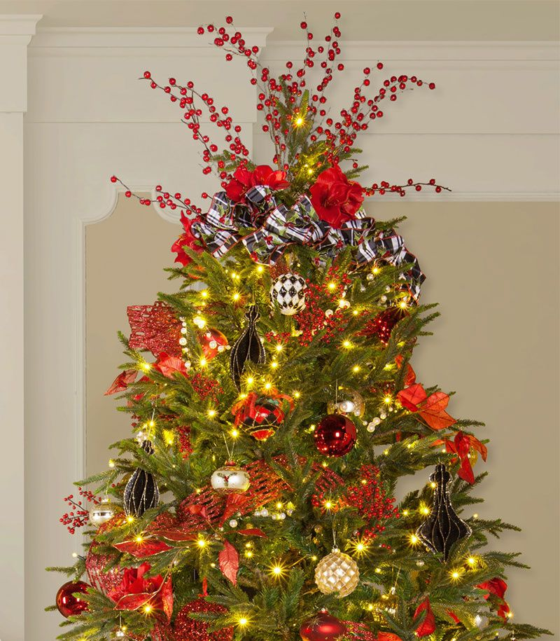 Prelit Christmas Tree Decorated With A Bow Topper