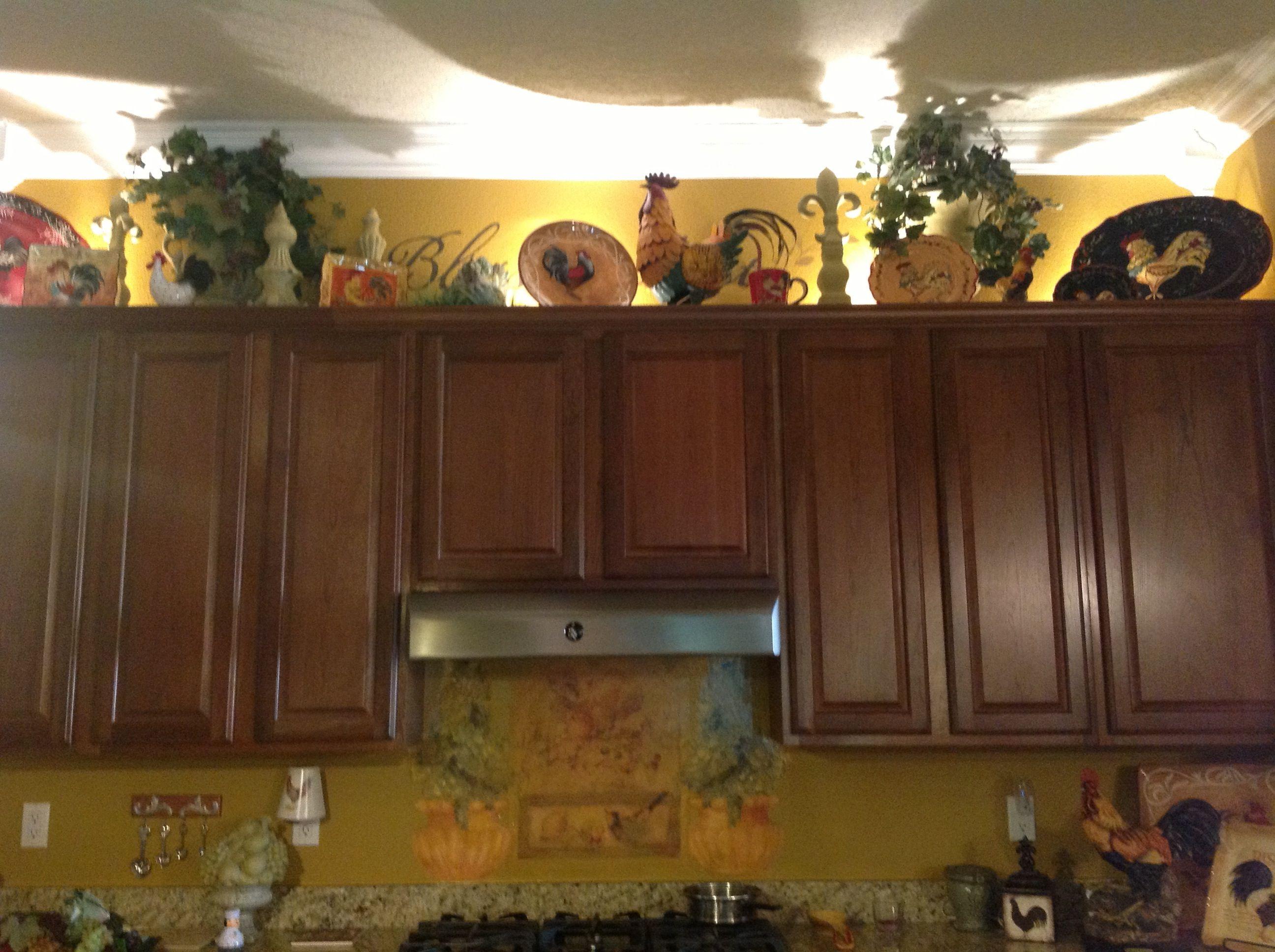 Over the cabinets chicken decor flower arrangements by for Chicken kitchen decorating ideas