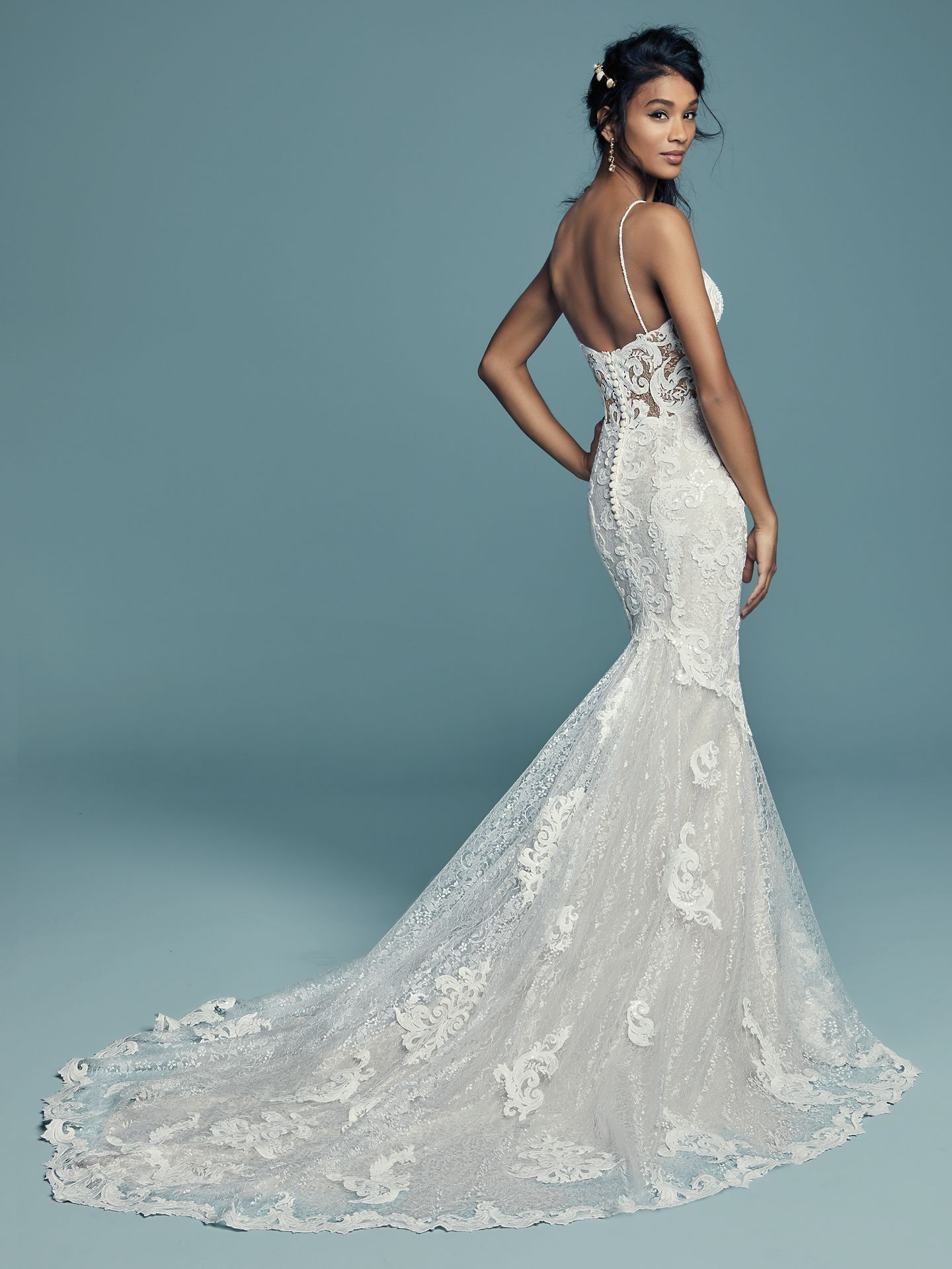 3ab51fab1d Tuscany Lynette by  MaggieSottero. Shimmering lace motifs waltz over  allover lace in this romantic sheath wedding dress