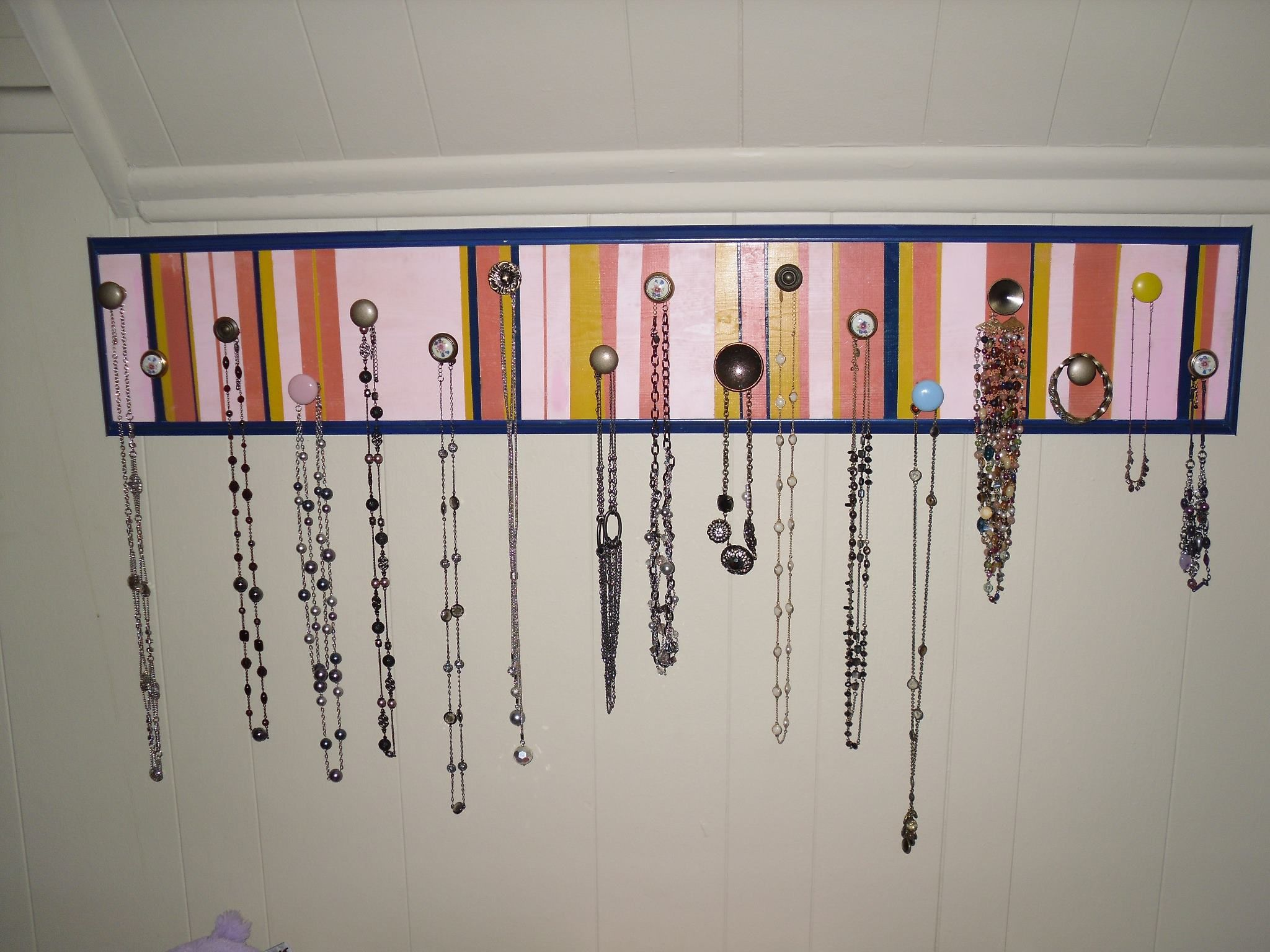 Jewelry holder/wall art... I ran out of space so decided to add decoration and purpose together.