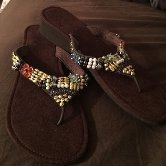 17597e62df8867 Summer Ready Flip Flop These cute brown sandals are ready for a little summer  time action. Comfortable sandals faux jewels and beads of assorted colors.