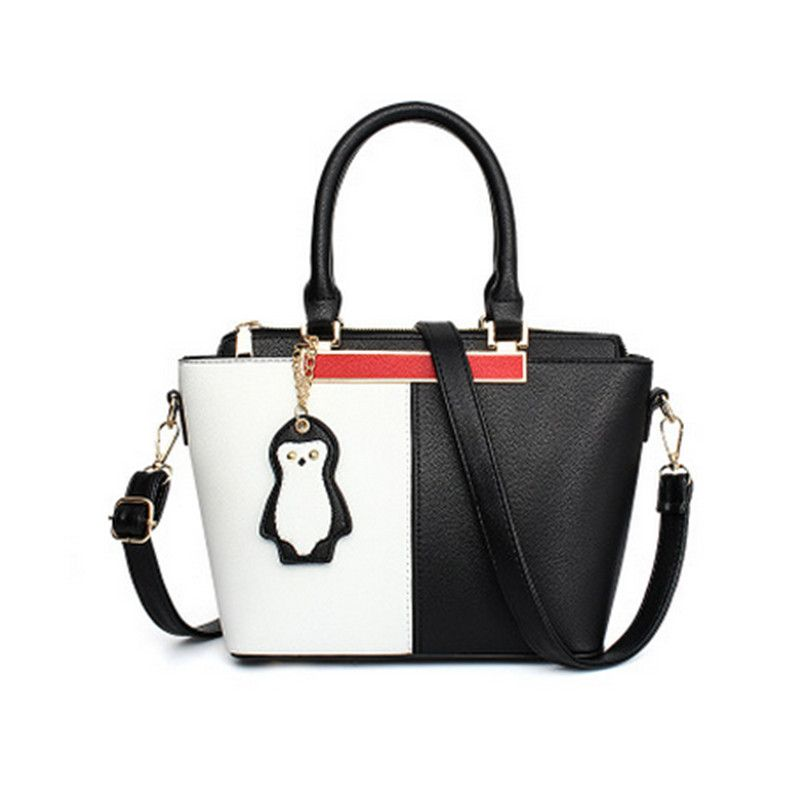 7576f98cd95f Stitching woman handbag fashion hit color shoulder bag cute penguin ...