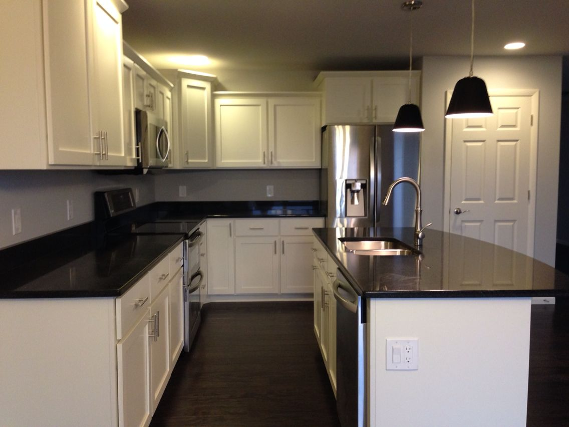 Kitchen With White Shaker Cabinets, Black Quartz
