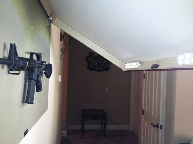 How to hide a gun with a picture frame guns gun storage for Picture frame organization wall