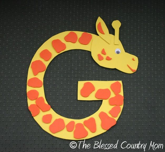 Letter G Giraffe | We made a G arden with his sticky foam flowers and critters. He is ...