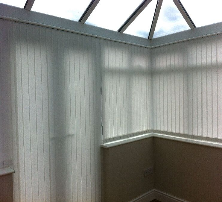 A Conservatory Fitted In White Portland Vertical Blinds In