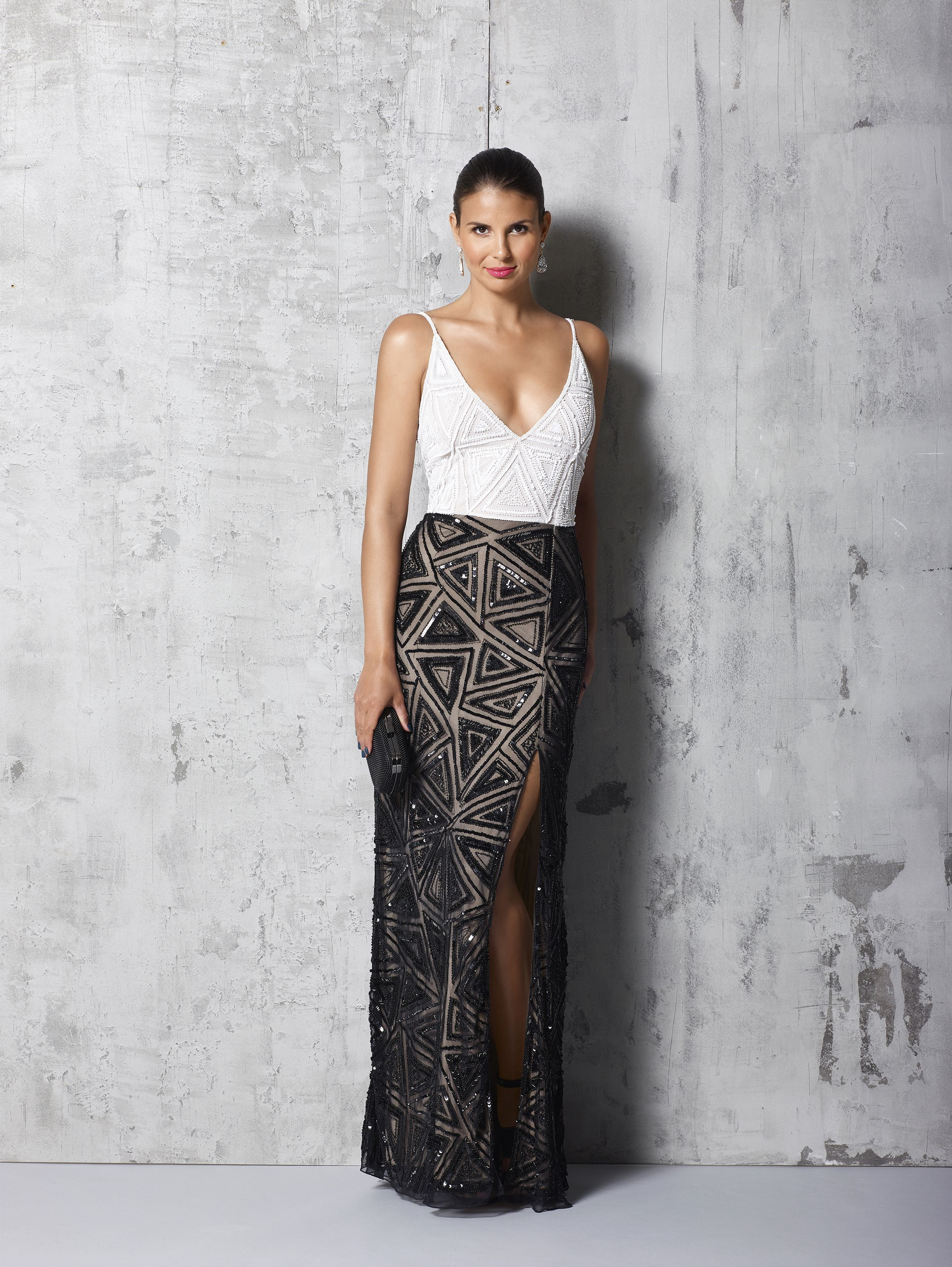 Sizes: 6-20 Sexy and elegant black and white long beaded dress by Mr K.    Click here to find your nearest stockist