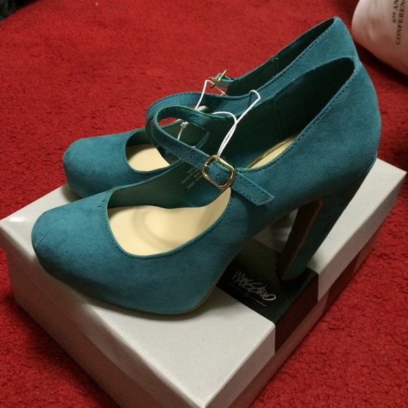 NWB Mossimo Pernella Pumps Brand new with box. Teal colored. There is a minor flaw which is shown in the last pic. It is not noticeable. I think it's glue. Mary Jane style. Mossimo Supply Co. Shoes Platforms