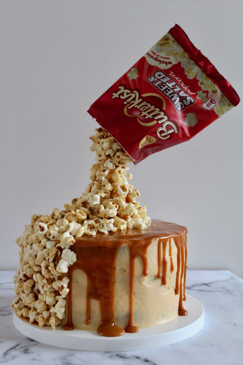 Vanilla sponge paired with silky smooth caramel swiss meringue buttercream, drizzled with more caramel and finished off with a pile of popcorn. This gravity-defying cake looks pretty… #gravitycake