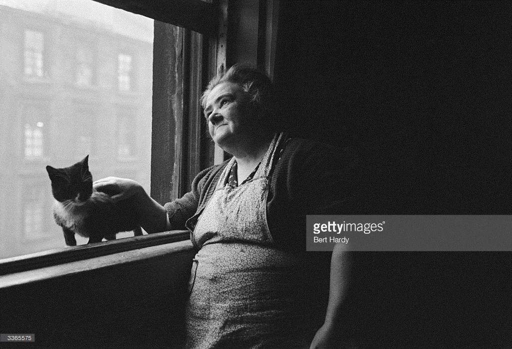 A Glaswegian woman and her pet cat at her home in the