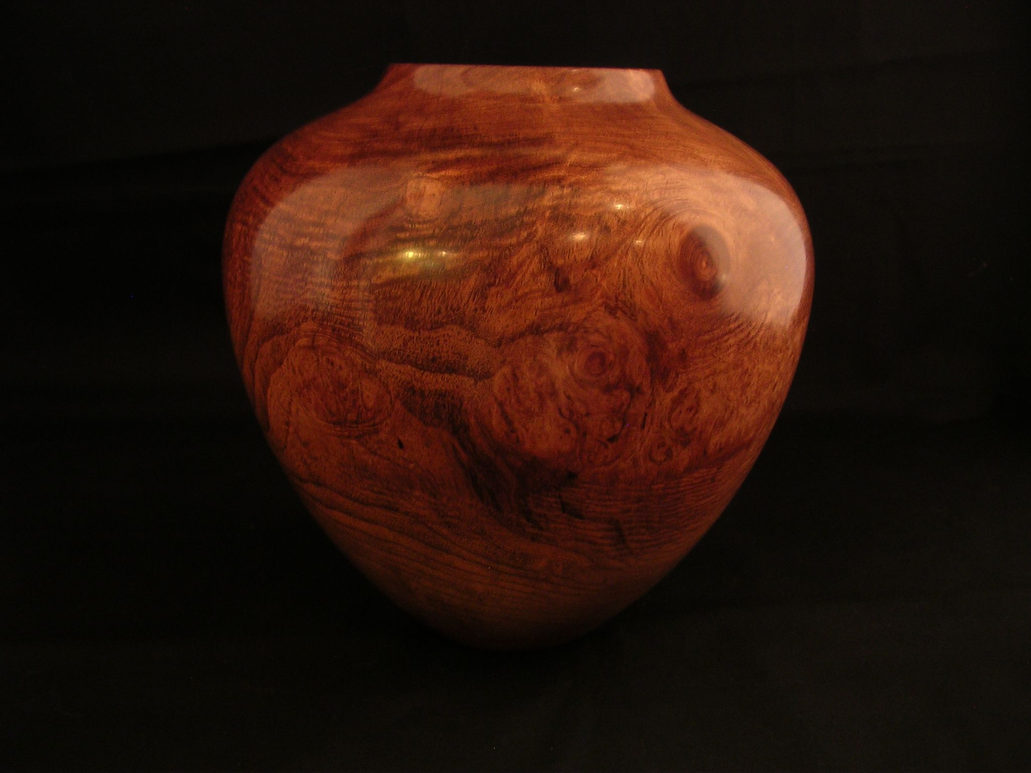 Gorgeous shape and color -- it's Mesquite, of course. The feel is warm and smooth. All-in-all a beautiful showpiece.   by my talented husband -- Paul Kendall, Mostly Mesquite    www.pkendall.com