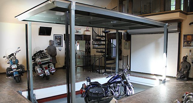 Awesome Underground Garage Design at Lower House Adorable Home Underground Garage Design Idea Integrating Elevator For Car And Motorcycle P. : motorcycle garage storage lift  - Aquiesqueretaro.Com