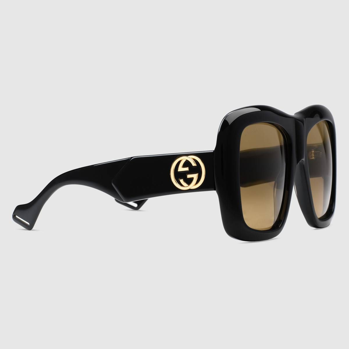 c5fe8df27ac Shop the Oversize square-frame sunglasses by Gucci. The brown lens adds a  vintage