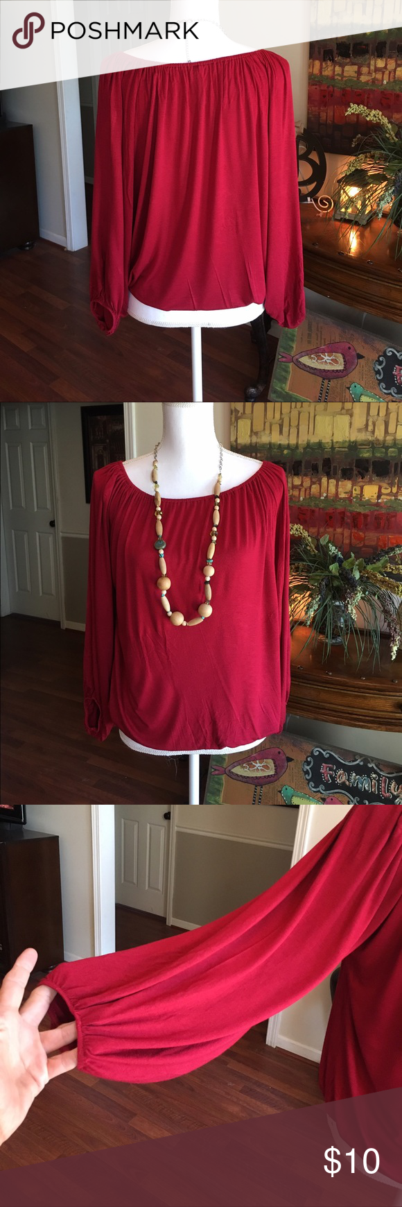 Emma Rose top Emma Rose burgundy top. Elastic at bottom of shirt and on the end of the sleeves.  So easy to wear. No tucking.  Looks good with jeans!  Thanks for looking in my closet!💋 Emma Rose Tops Blouses