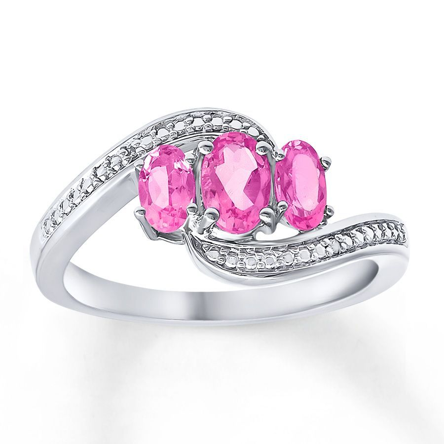 Oval lab-created pink sapphires form a colorful trio in the center ...